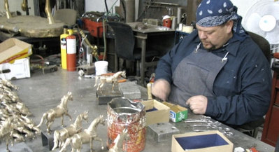 Carey Hosterman chasing with meticulous detail at Rocky Mountain Bronze Shop in Loveland Colorado