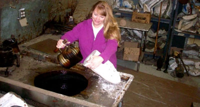 Amy Hosterman of Rocky Mountain Bronze Shop in Loveland Colorado works with wax